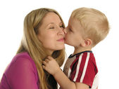 Son kissing mother — Stock Photo