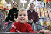 Boy with parents in shop — Stock Photo
