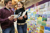 Couple in postcards shop — Stock Photo