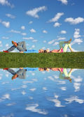 Couple lies under clouds — Stock Photo