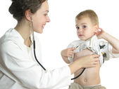 Doctor assessing patient by stethoscope — Stock Photo