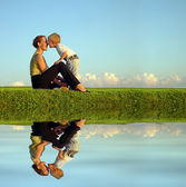 Mother with son on sundown kiss by nose. long. water — Stock Photo