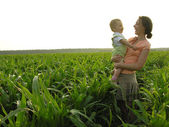 Mother with baby in field — Stock Photo