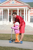Mother with baby on scooter in kuskovo moscow — Stock Photo