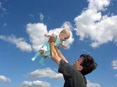 Father with baby in sky — Stock Photo