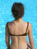 Behind girl and pool — Stock Photo