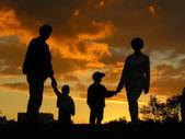 Familia de cuatro 2 al atardecer — Foto de Stock