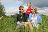 Family on meadow waiting next child — Stock Photo