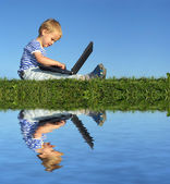 Child with notebook sit blue sky and water — Stock Photo