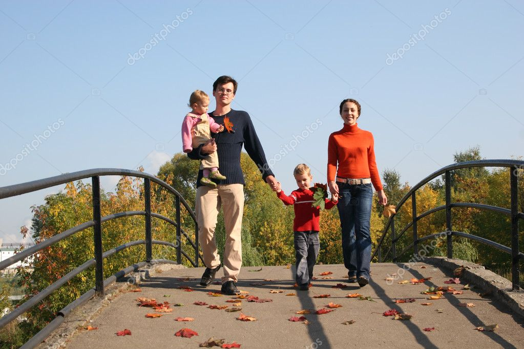 Family of four on bridge — Stock Photo #3538047