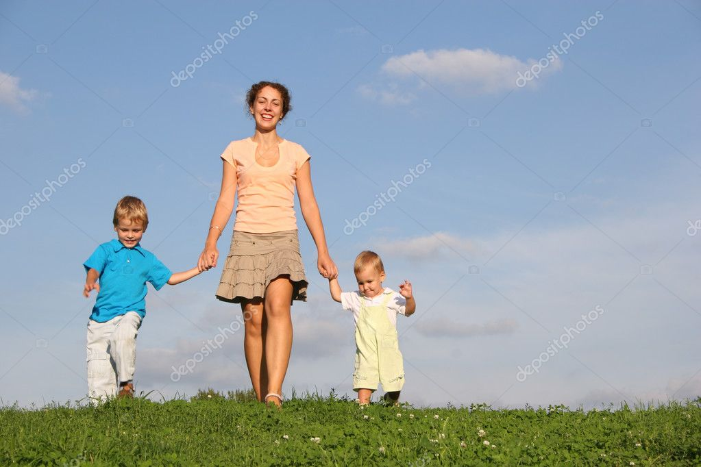 Mother with children on meadow  Stock Photo #3538396