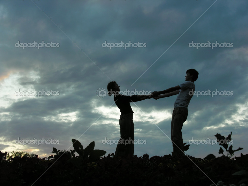Couple on evening sky — Stock Photo #3538788