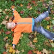 Autumn child lies like star — Stock Photo #3540028