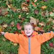 Autumn child lies — Stock Photo #3540033