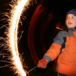 Child with moving sparkler — Stock Photo #3540139