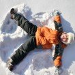 Boy lies on north pole snow — Stok fotoğraf