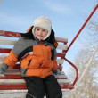 Boy on winter seesaw — Stock Photo