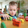 Child in kindergarten - Stock Photo