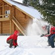 Couple winter house throw snow — Stock Photo #3540374