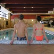 Couple and swimming pool - Stock Photo