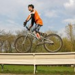 Stock Photo: Biker on bench 2