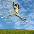 Jump girl under cloud sky — Foto Stock