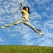 Jump girl under cloud sky — Stok fotoğraf