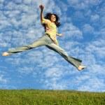Jump girl under cloud sky — Stock Photo