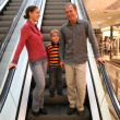 Stock Photo: Family on elevator shop
