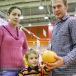 Family and orange — Stock Photo #3540676