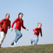 Running family with son — Stock Photo