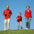 Running family with son 3 — Stock Photo