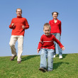 Stock Photo: Running family with son 2