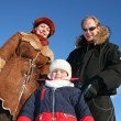 Winter boy with parents — Stock Photo
