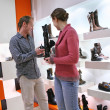 Stock Photo: Couple in shoes shop
