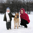 Family with dog. winter - Stok fotoraf