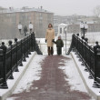Mother with son on winter bridge — Stock Photo #3540822