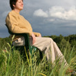 Stock Photo: Woman resting on meadow