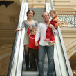 Family of four on escalator — Stock Photo #3540924