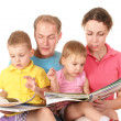 Family of four read books — Stock Photo