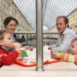 Family in cafe in big shop — Stock Photo