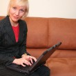 Business woman with notebook on sofa — Stock Photo #3540990