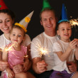 Family of four with sparklers — Stock Photo