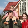 Family with baby and house — Stock Photo