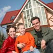 Stock Photo: Smile family and house