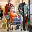 Family with children in shop — Stock Photo #3541050