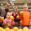 Family with oranges — Stock Photo