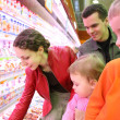 Stock Photo: Family in food shop