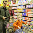 Family of four in shop 2 — Stock Photo