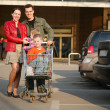 Stock Photo: Family on shop parking 2